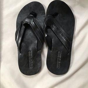 Black leather Hobibear Flip Flops